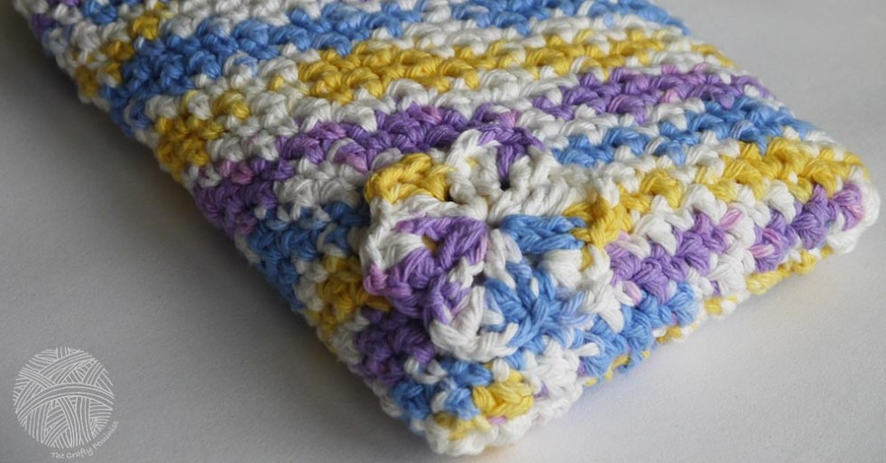 A rice bag in a multi-coloured crochet cover