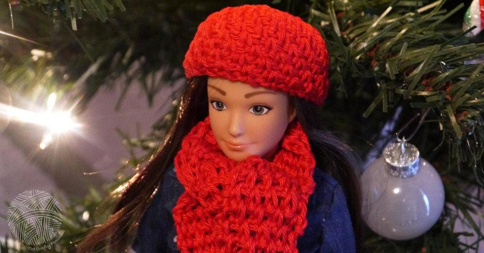 "The ""Traveller"" Lammily doll wearing a red crocheted hat and scarf"
